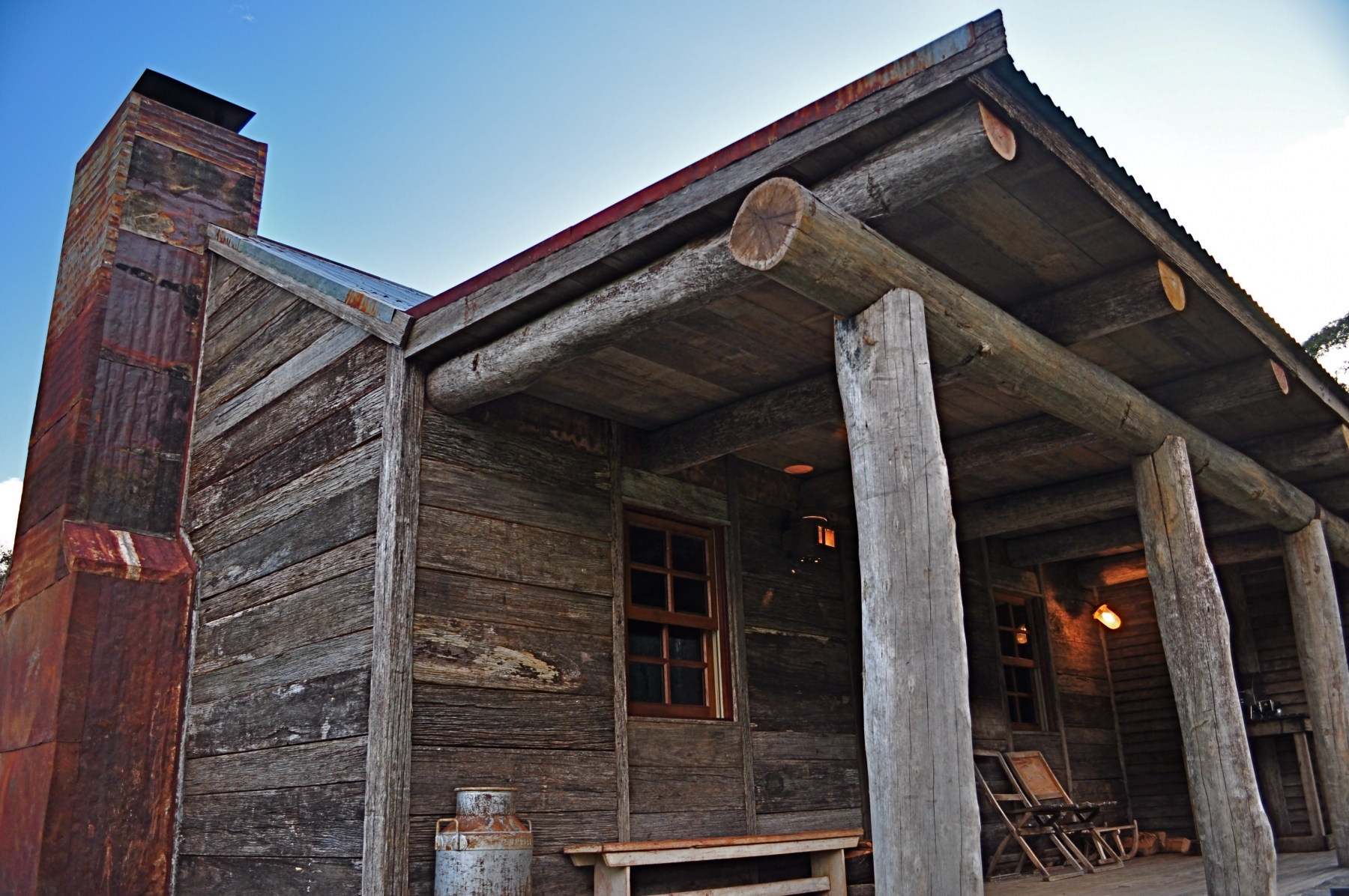Moonbah River Hut - Luxury riverside log cabin with large open log fireplace